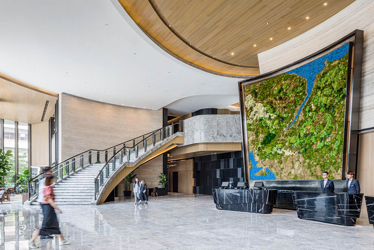 alva-homepage-banner-hotel-interior-lobby-moss-wall